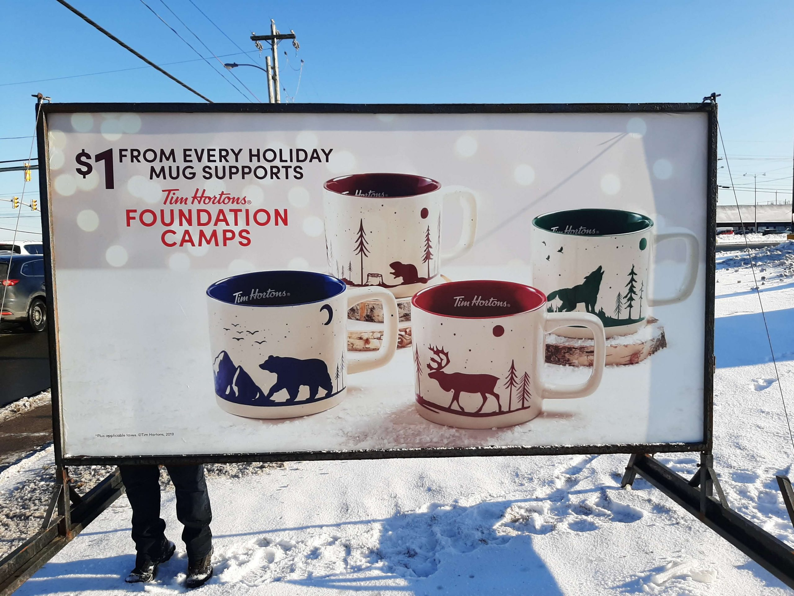 Tim Hortons foundation camps sign with mugs
